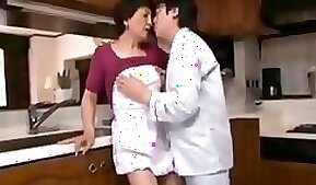 Sexy mommy in the kitchen
